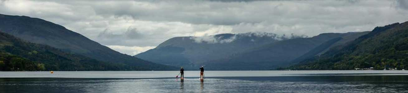 stand up paddle boarding with unique adventure tours scotland