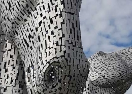 The Kelpies are 30-metre-high horse-head sculptures depicting kelpies, standing next to a new extension to the Forth and Clyde Canal, and near River Carron, in The Helix
