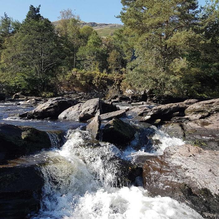 The Falls of Dochart in Killin with Unique Adventure Tours Scotland
