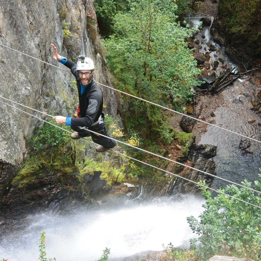 Walking the wire bridge at the Via Ferrata at Kinlochleven