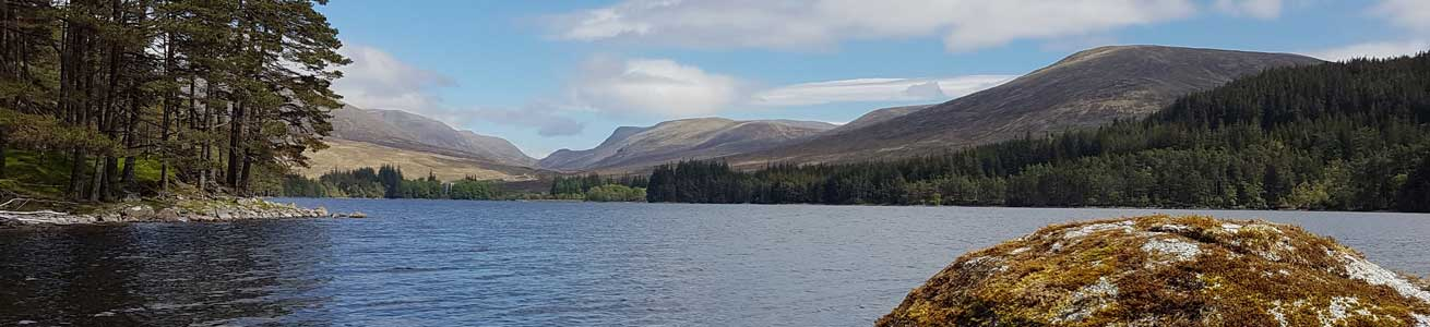 Views over Loch Ossian in the Scottish Highlands - adventure tours Scotland