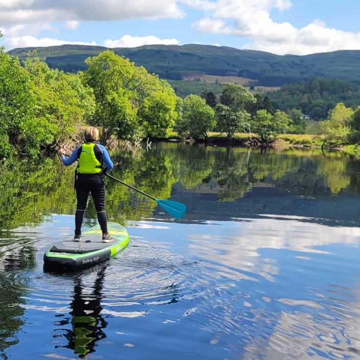 Paddleboarding in wide open natural environments to relax and refresh